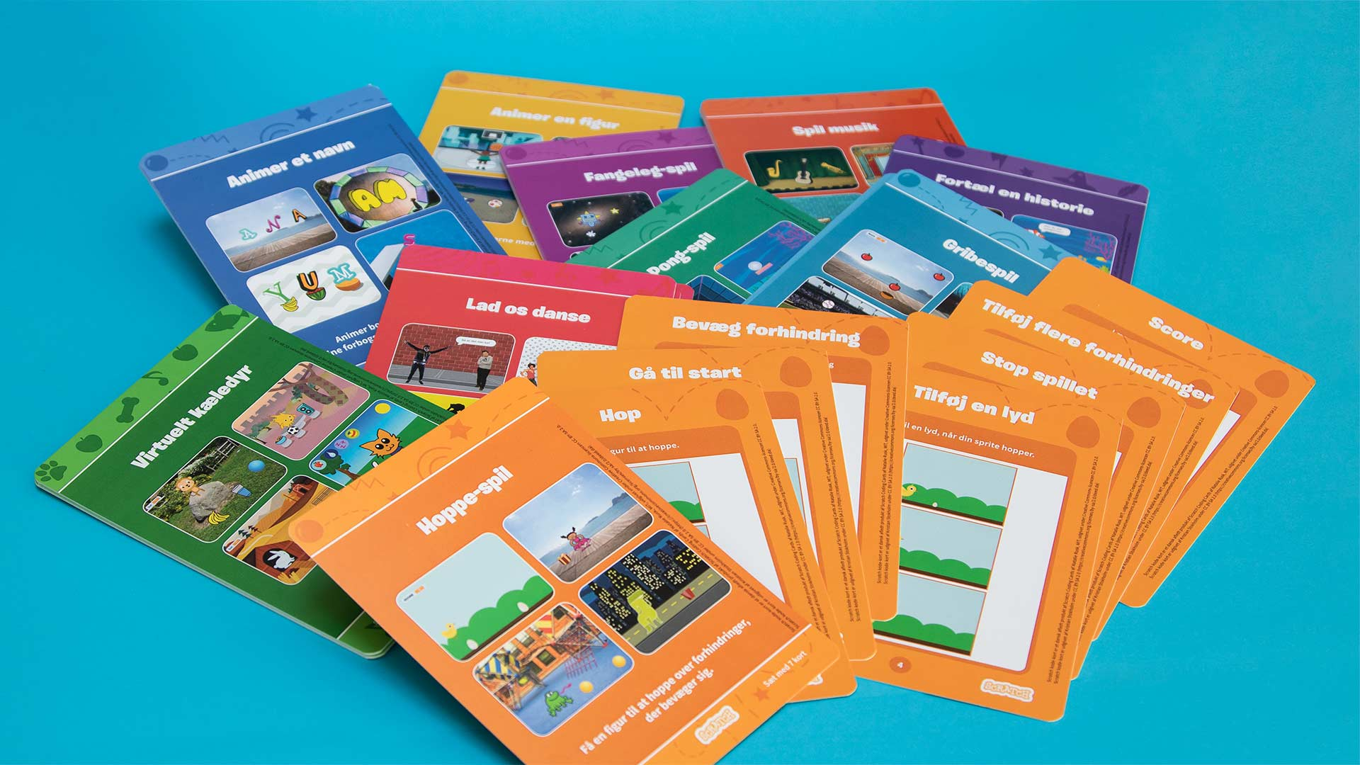 Scratch kode-kort sæt på dansk med 10 kortserier.